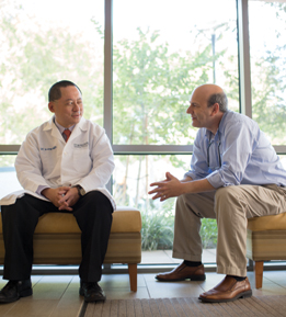 Dr. Sai-Hong Ignatius Ou talks with lung cancer patient Dr. Allen Freemont