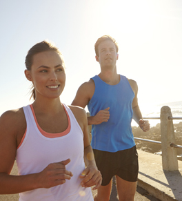 A woman and man jogging outdoors