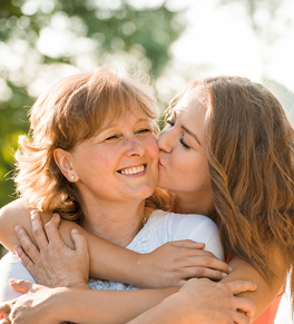 gynecologic cancer survival; mother, daughter hugging and smiling