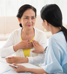 asian woman with hereditary heart attack risk visiting nurse