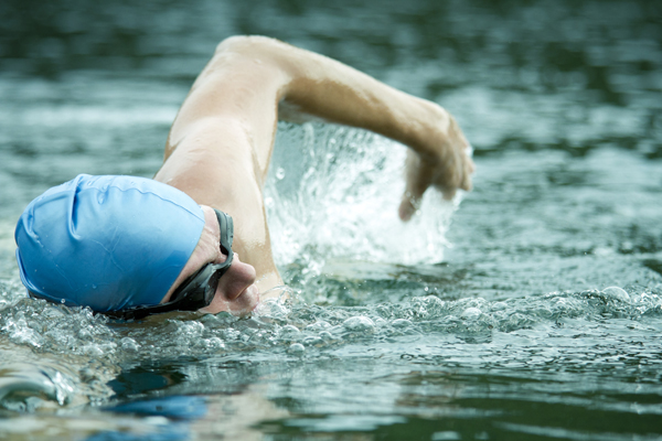 man swimming for arthritis relief