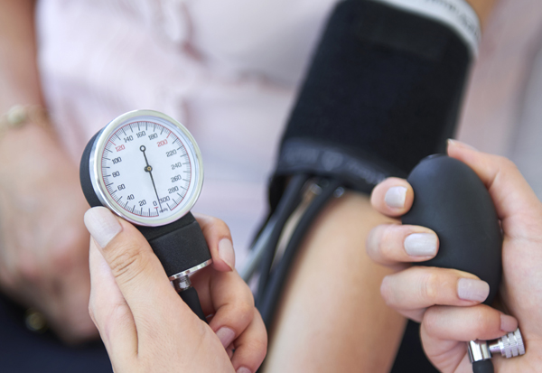 person blood pressure checked before taking decongestant for allergies
