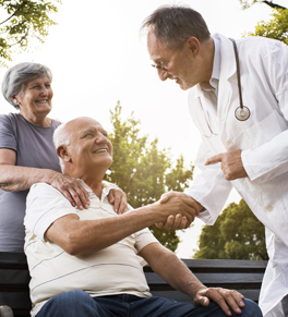 male physician shaking male patient's hand