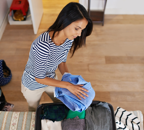 woman packing for vacation