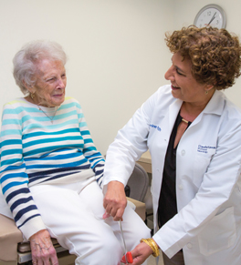UCI Health geriatrician claudia kawas with a patient
