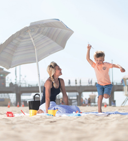 megan davis on the beach with her son, Nolan