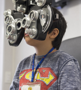 young boy having vision tested