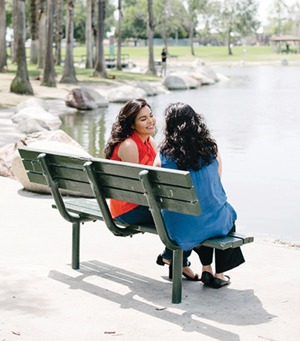 xenia and nadia morales sitting on a bench
