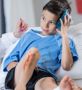 boy with concussion at doctor's