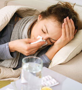 woman with flu, coughing, sneezing, sick