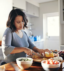 woman preparing healthy foods