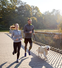 couple and dog exercising together