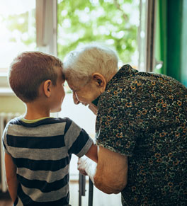 frail elderly woman with young boy