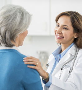 doctor talking with breast cancer patient
