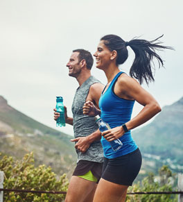 man and woman training for a race