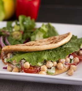 chickpea salad in pita with side salad