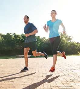 man and woman jogging to reduce stroke risk