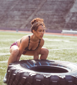 young woman doing intense exercise