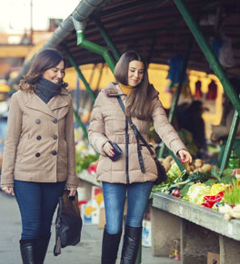 two women shopping for food