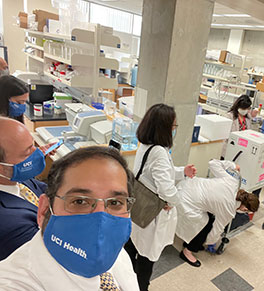 Dr. Cyrus Dastur, director of neurocritical care at UCI Health, watches the delivery of the first shipment of COVID-19 vaccines to UCI Medical Center.