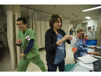 Carmen Morales, center, and Barbara Kaess, right, share a laugh with trauma tech Boris Chung, on left