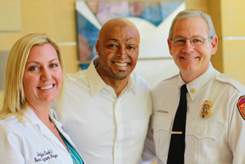 J.R. Martinez pictured with Jennifer Cash, RN, UCI Health Burn Program Manager and Randy Bruegman, Anaheim Fire Chief
