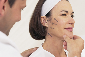 Plastic surgeon marks areas for a patient's cosmetic procedure
