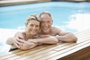 Middle-aged couple in a pool