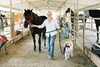 UC Irvine Health ovarian cancer patient Meg Newton with her horses