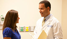Dr. Robert E. Bristow, UCI Health gynecologic oncologist, talks with a patient.