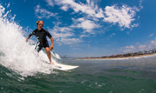 Charles Scalice of Seal Beach was determined to survive rectal cancer and keep surfing.