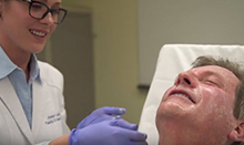 Plastic surgeon Dr. Amber Leis demonstrates a chemical peel on Dr. Greg Evans, head of Aesthetic & Plastic Surgery Services at UCI Health.