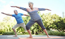 man and woman doing yoga for arthritis