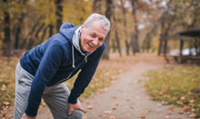 man with back pain smiling after exercise