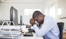 man with insomnia at work desk asleep