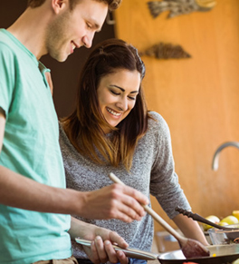 young couple cooking healthy for stronger hearts