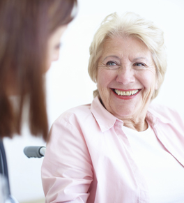 Senior woman talking to doctor