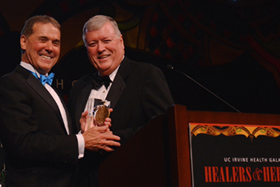 UC Irvine Health CEO Terry Belmont presents the leadership award to philanthropist Michael Hayde at the 2014 UC Irvine Health gala, Healers & Heroes.