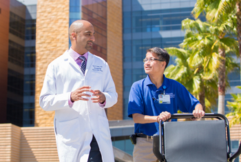 Volunteer Robert Nguyen and Dr. Sunil Verma, director of the University Voice and Swallowing Center