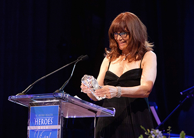Susan Samueli, founder of the UC Irvine Health Susan Samueli Center for Integrative Medicine, accepts the Hero award at the 2015 UC Irvine Health Heroes gala.