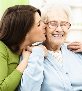 woman kissing older family member