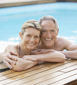 older man and woman in pool