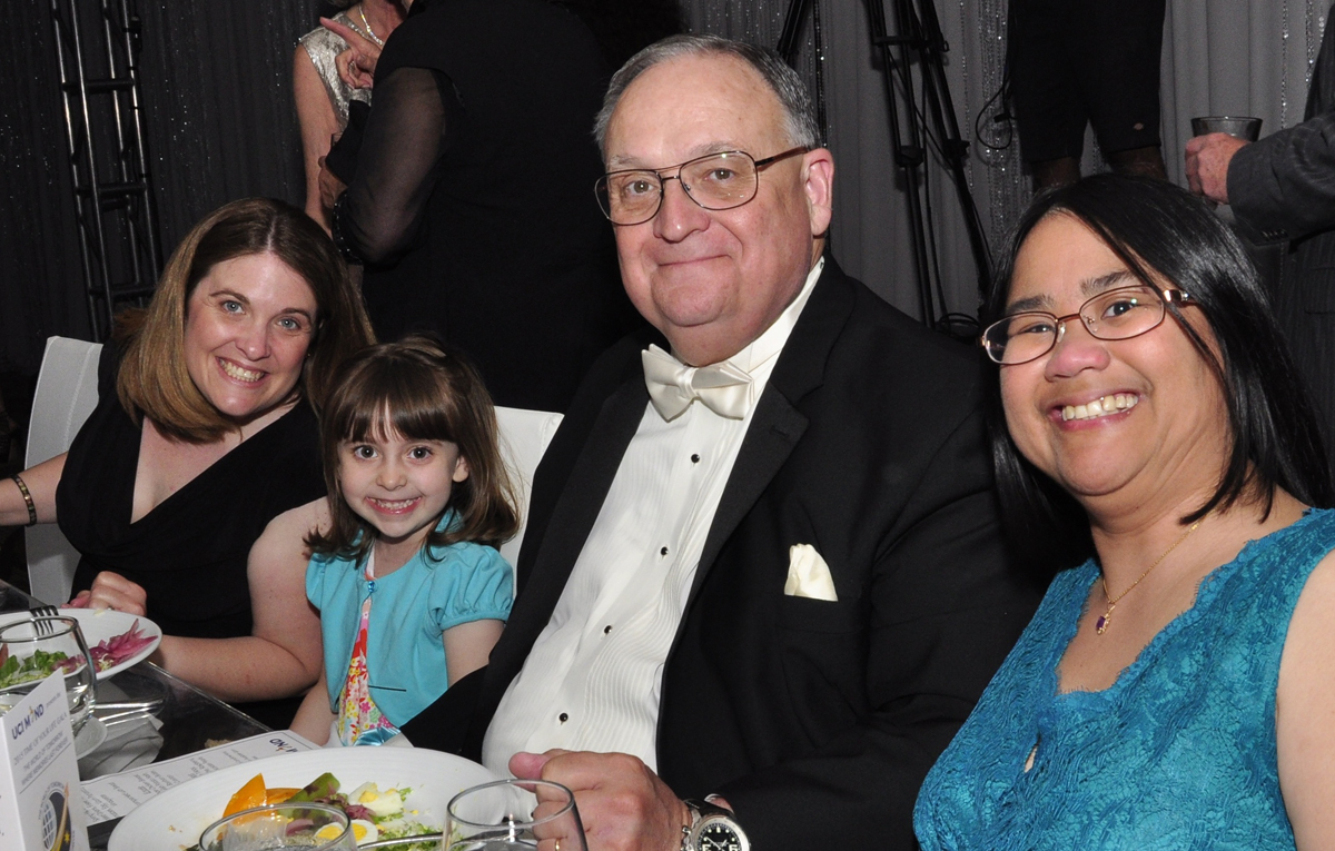 Bill Edwards with his two daughters and granddaughter