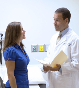 Dr. Robert Bristow talks with patient