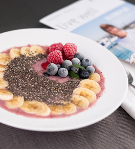 smoothie bowl with bananas, fruit, chia seeds