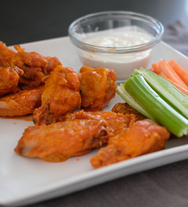 baked chicken wings with celery, carrots and blue cheese