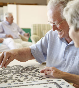 man with parkinson's disease playing puzzle