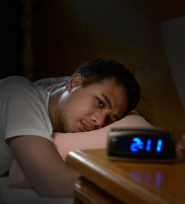 man lying awake in the middle of the night