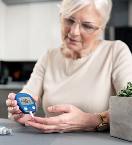 woman with diabetes checking her blood glucose levels