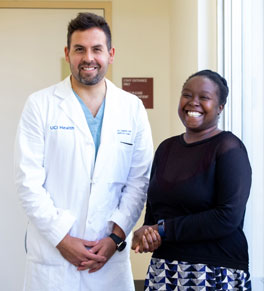 uci health cardiologist dr. fabio sagebin and patient fried kyalo